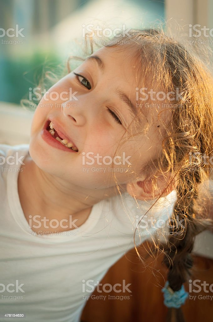 Cute little girl winking stock photo