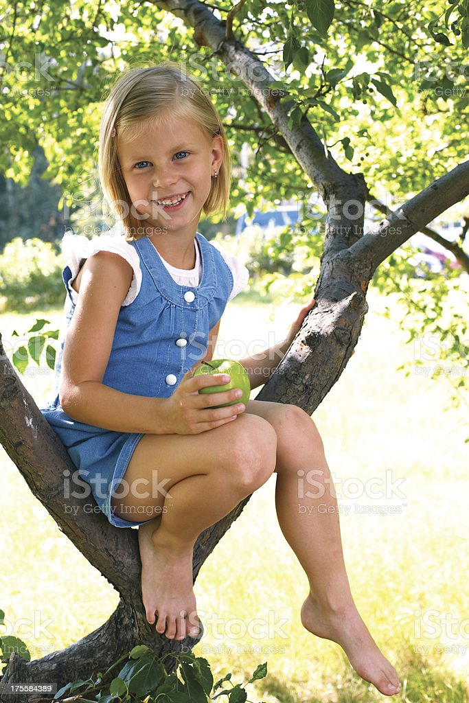 Cute little girl with apple royalty-free stock photo