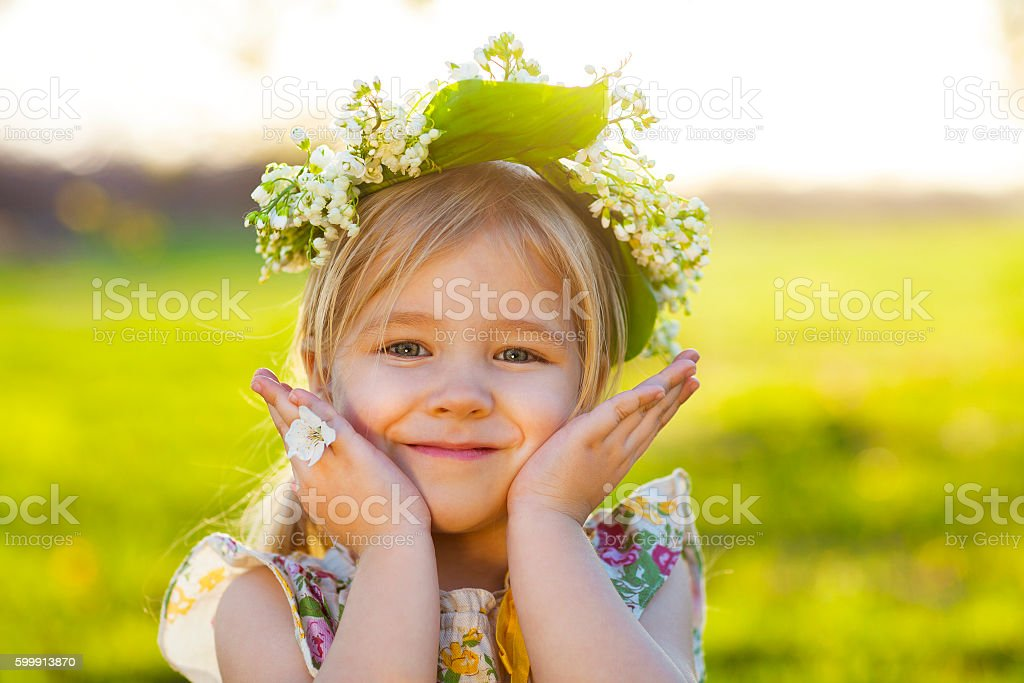 Cute little girl with blond hair in wreath stock photo