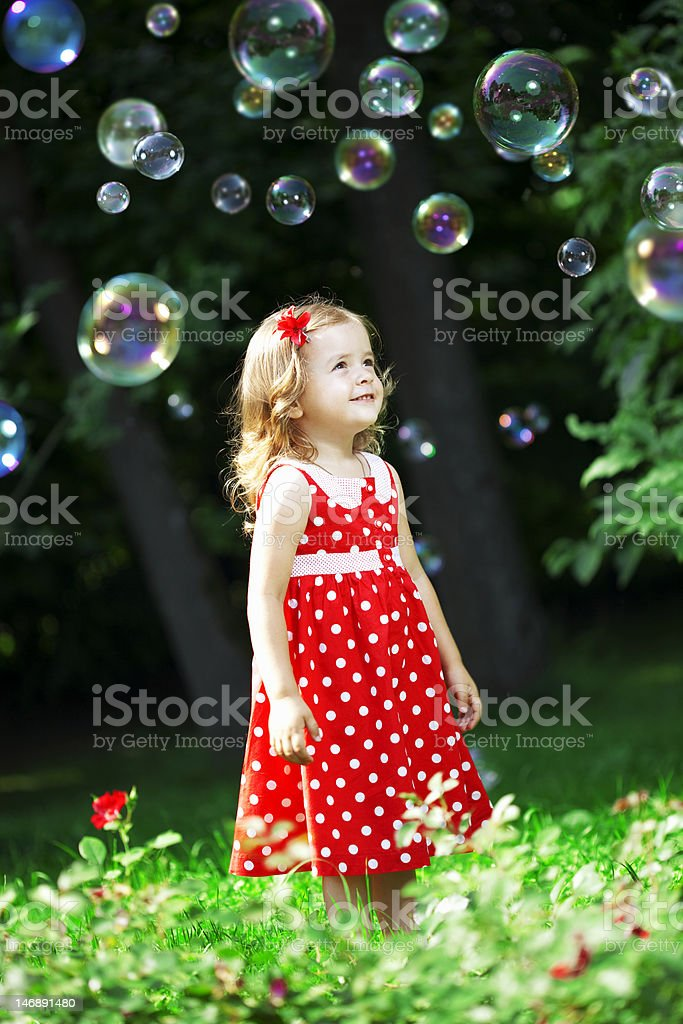 Cute little girl with bubbles royalty-free stock photo