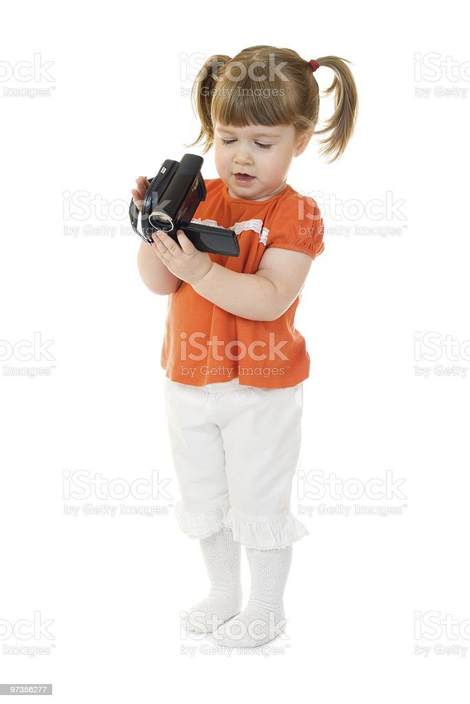 Cute little girl with camcoder stock photo