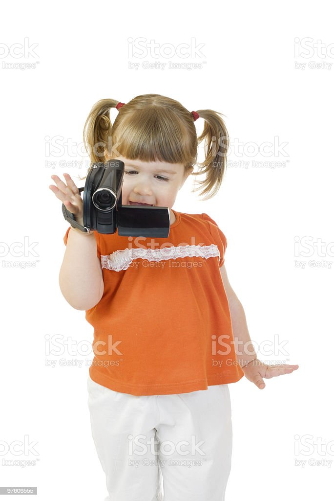 Cute little girl with camcoder royalty-free stock photo