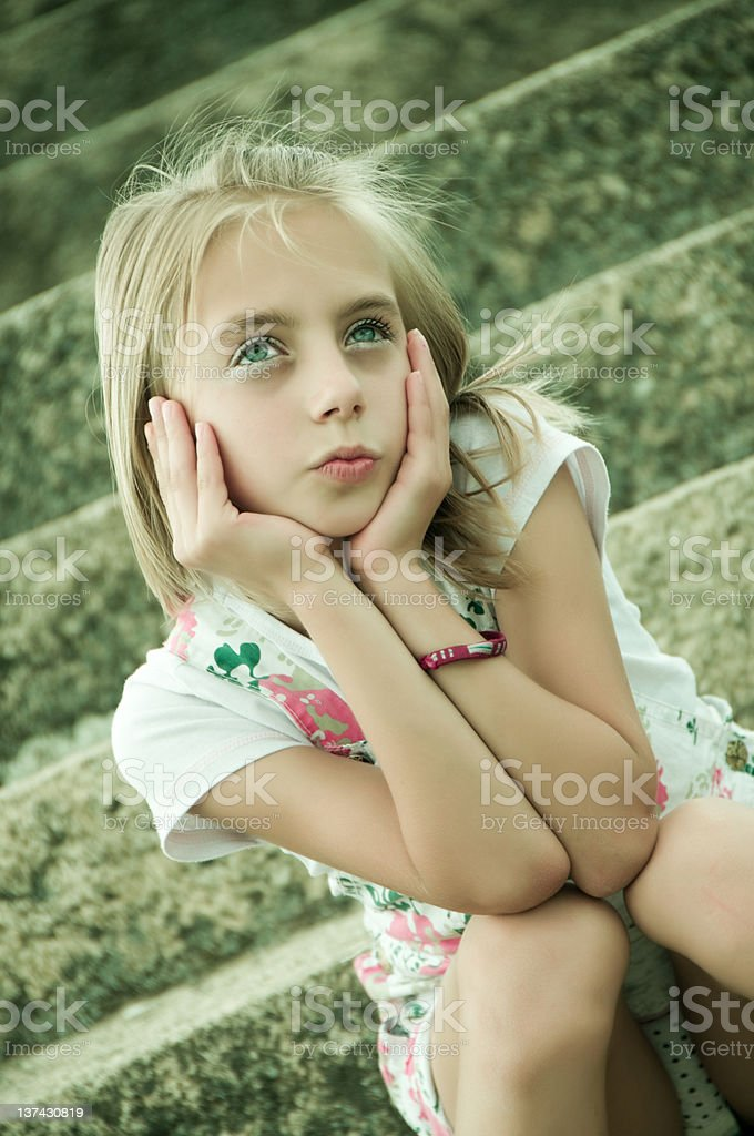 Cute Little Girl With Green Eyes stock photo