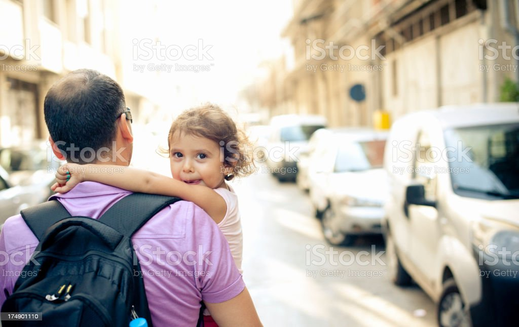 Cute Little Girl with Her Father in The City royalty-free stock photo
