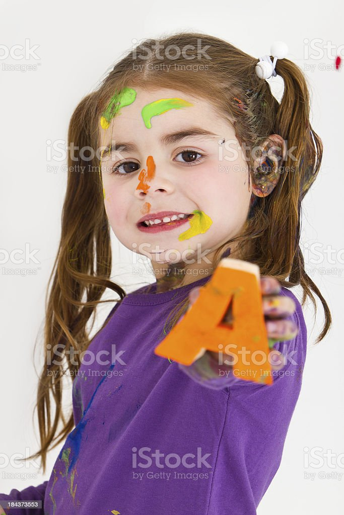 Cute little girl with letters stamps royalty-free stock photo