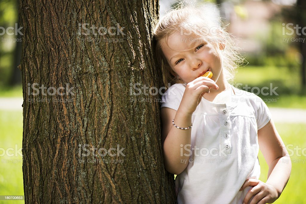 Cute Little Girl with Lollipop royalty-free stock photo