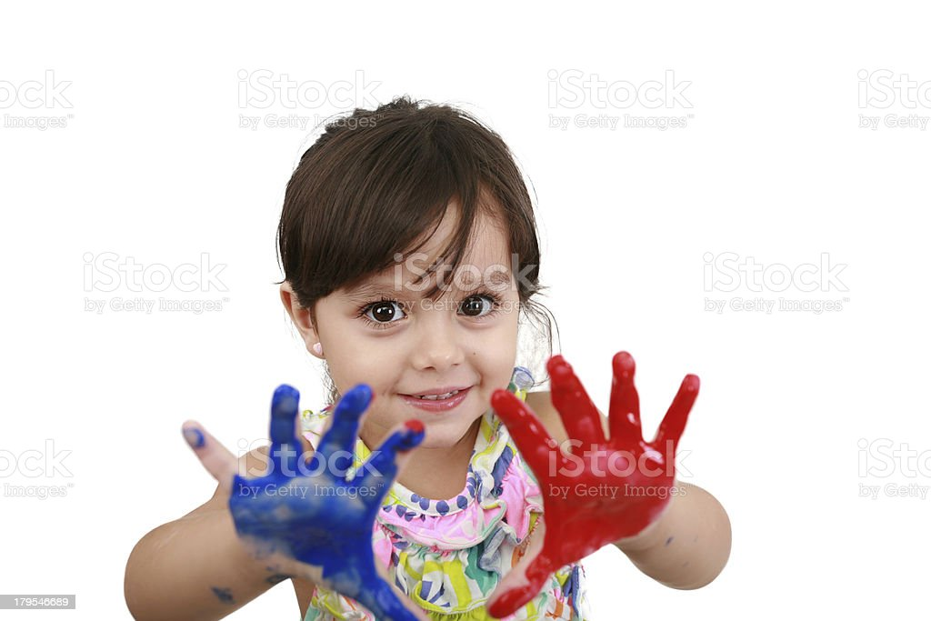 Cute little girl with painted hands. royalty-free stock photo