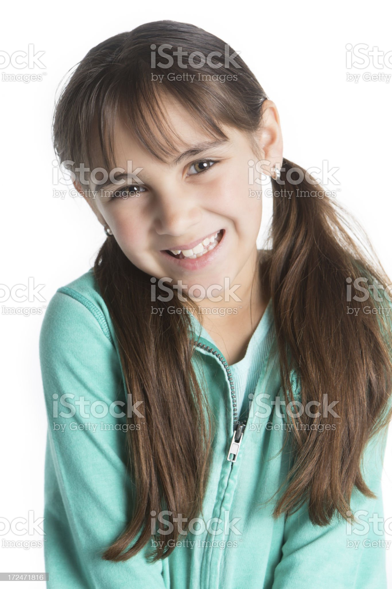 Cute little girl with pigtails and toothy smile on white royalty-free stock photo