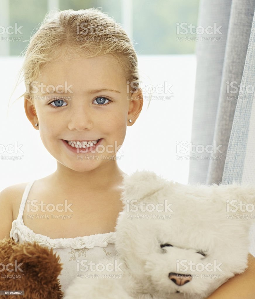 Cute little girl with teddy bears at home royalty-free stock photo