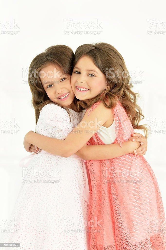 cute little girls posing stock photo