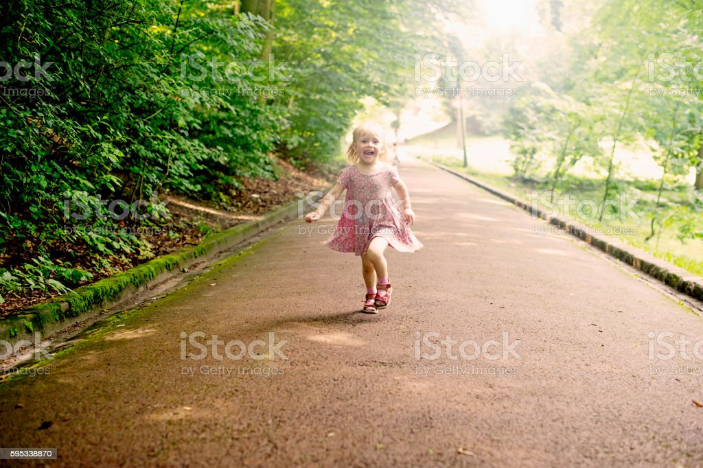 Cute little Girls Running at The Park / Nature stock photo