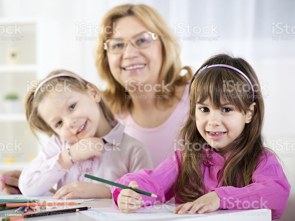Cute little girls with grandmother royalty-free stock photo