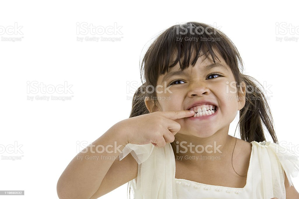 cute little kid showing her teeth stock photo