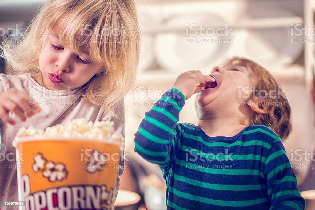 Cute Little Kids Eating Homemade Popcorn stock photo