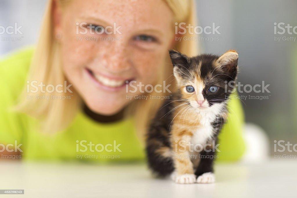 cute little kitten and teen girl royalty-free stock photo