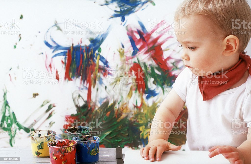Cute little pensive painter royalty-free stock photo