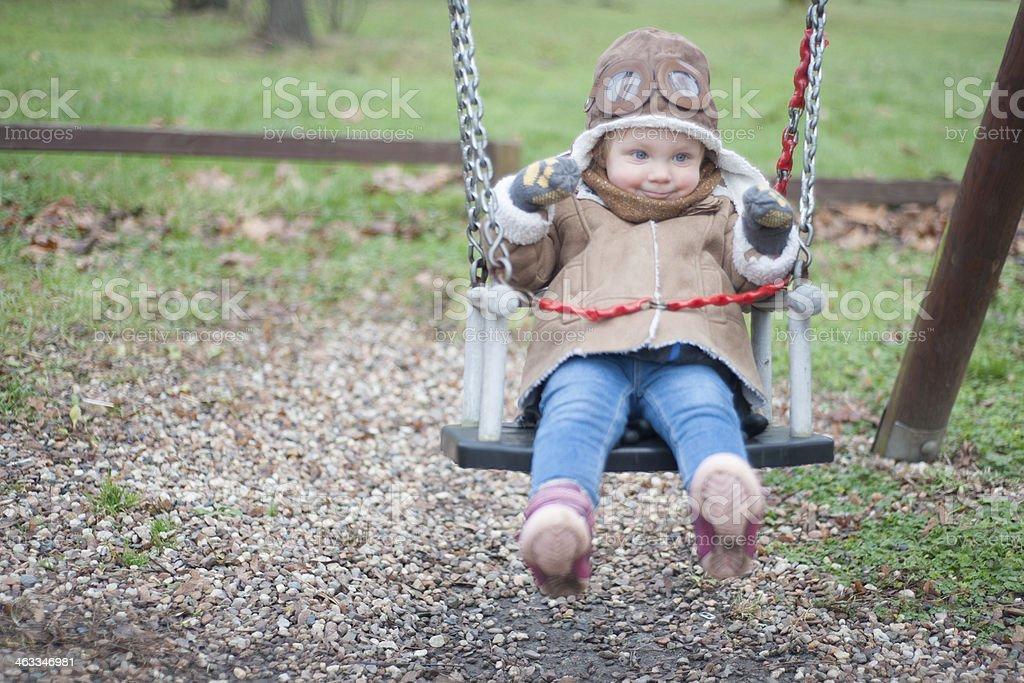 Cute little pilot on a swing stock photo