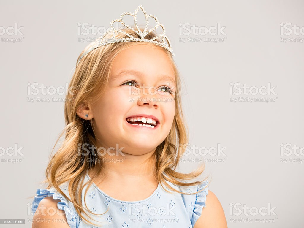 Cute little princess laughing stock photo