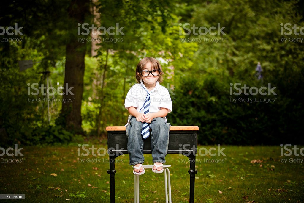 Cute Little School Boy Making a Face stock photo
