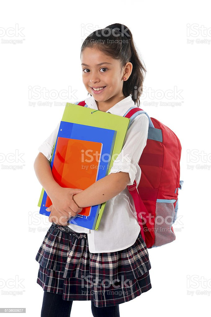 cute little school girl carrying schoolbag backpack and books smiling stock photo