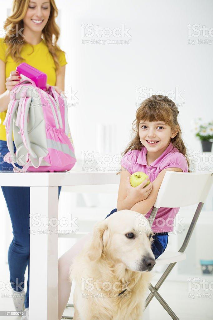 Cute Little School Girl Eating Apple. royalty-free stock photo