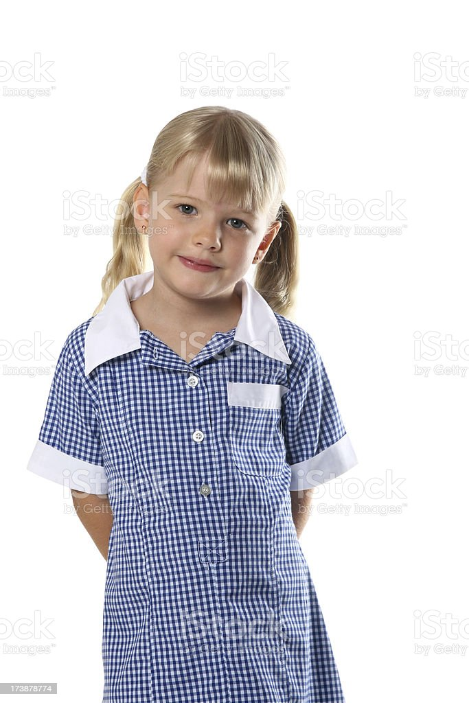 Cute Little School Girl in school uniform on white background royalty-free stock photo
