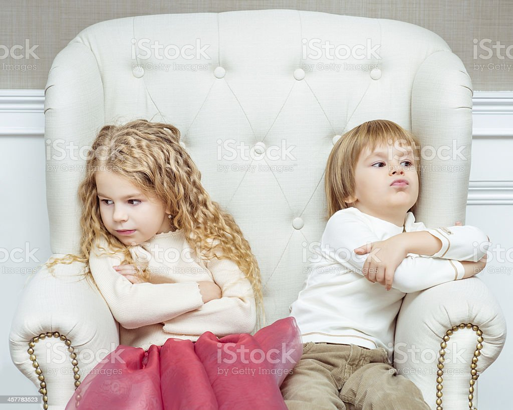 Cute little siblings being at odds with each othe stock photo
