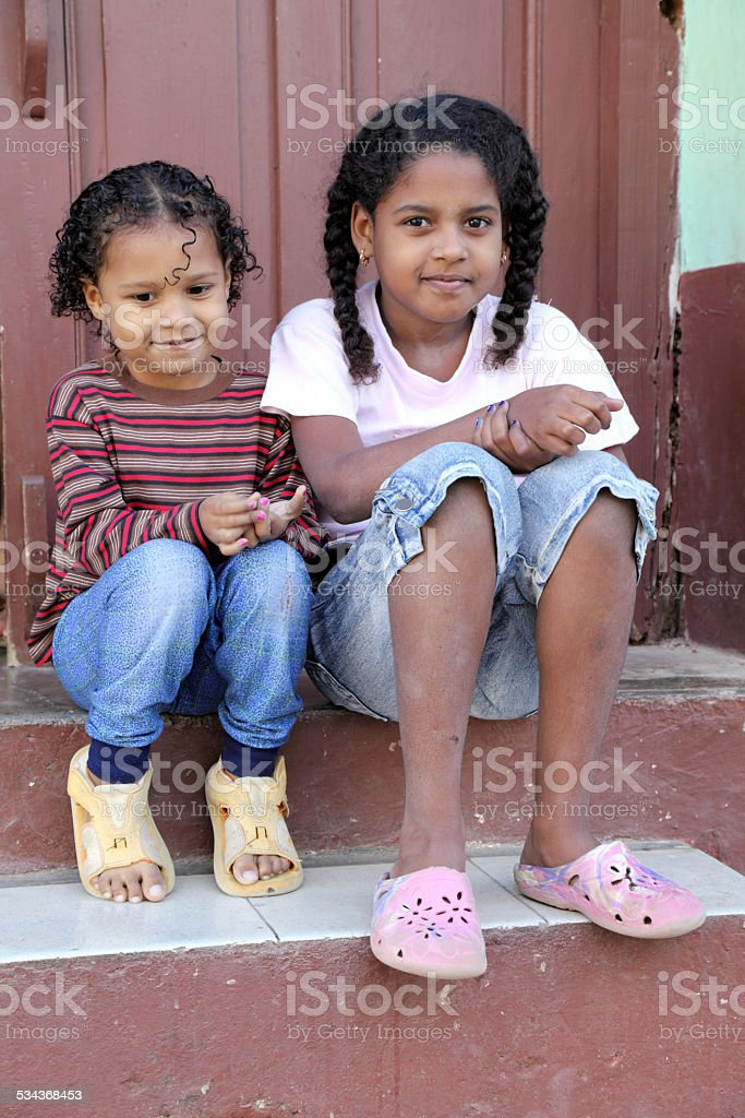 Cute little sisters stock photo