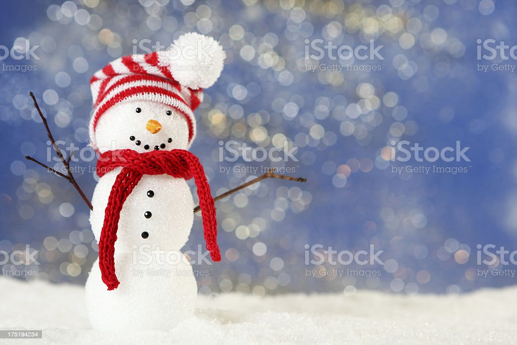 A cute little snowman wearing a hat and scarf royalty-free stock photo