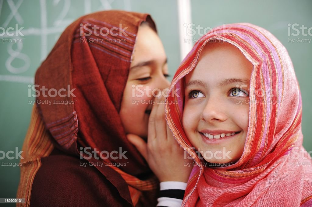 Cute lovely school children at classroom having education activi stock photo