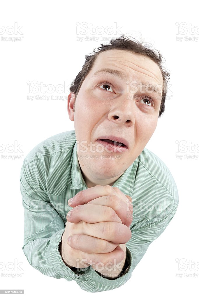 Cute man praying with puppy eyes stock photo