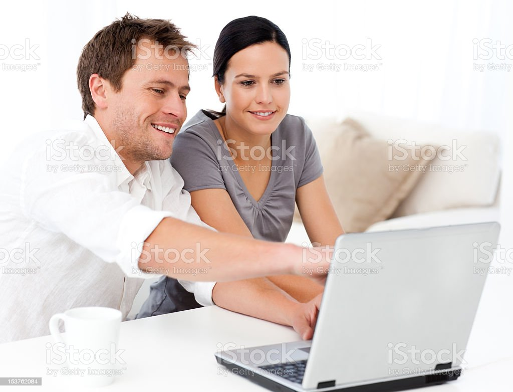 Cute man showing something on the laptop screen royalty-free stock photo
