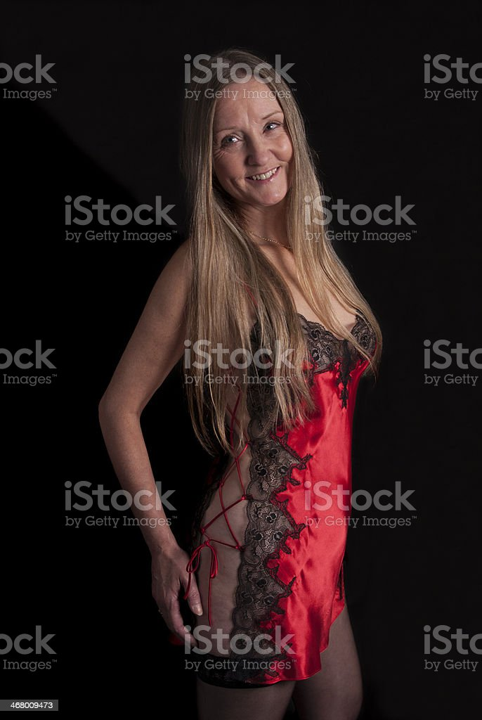 Cute Mature woman ready for bed in black and red stock photo