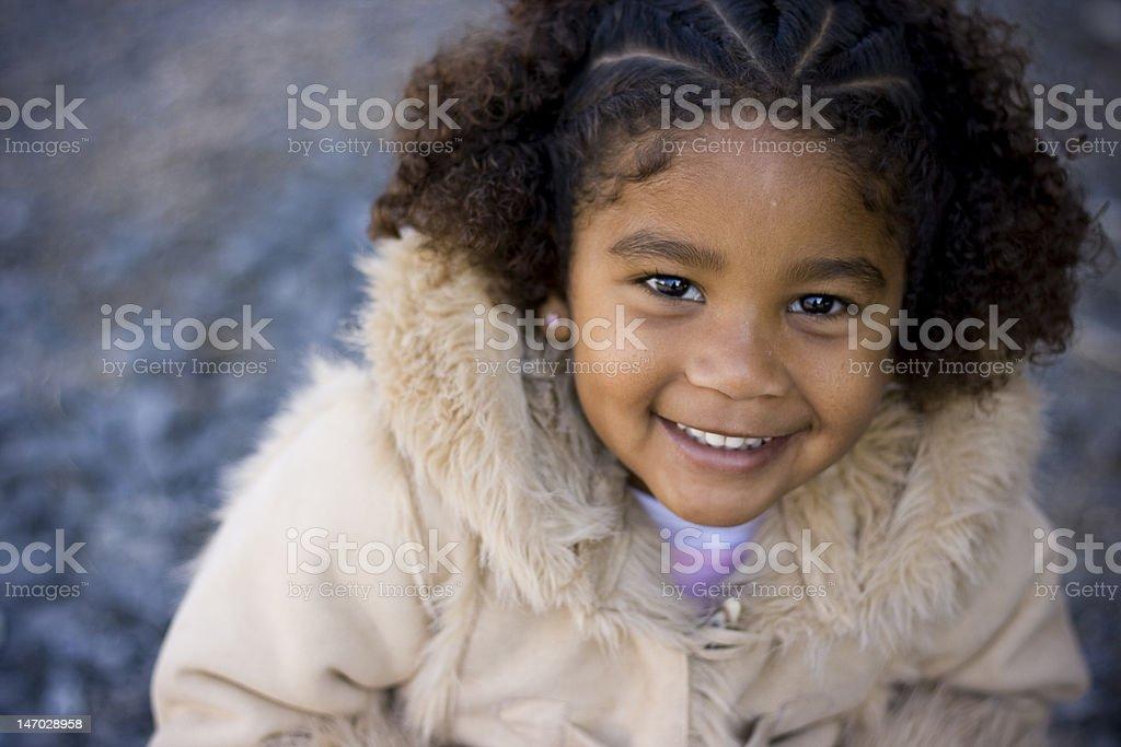 Cute mixed race little girl stock photo