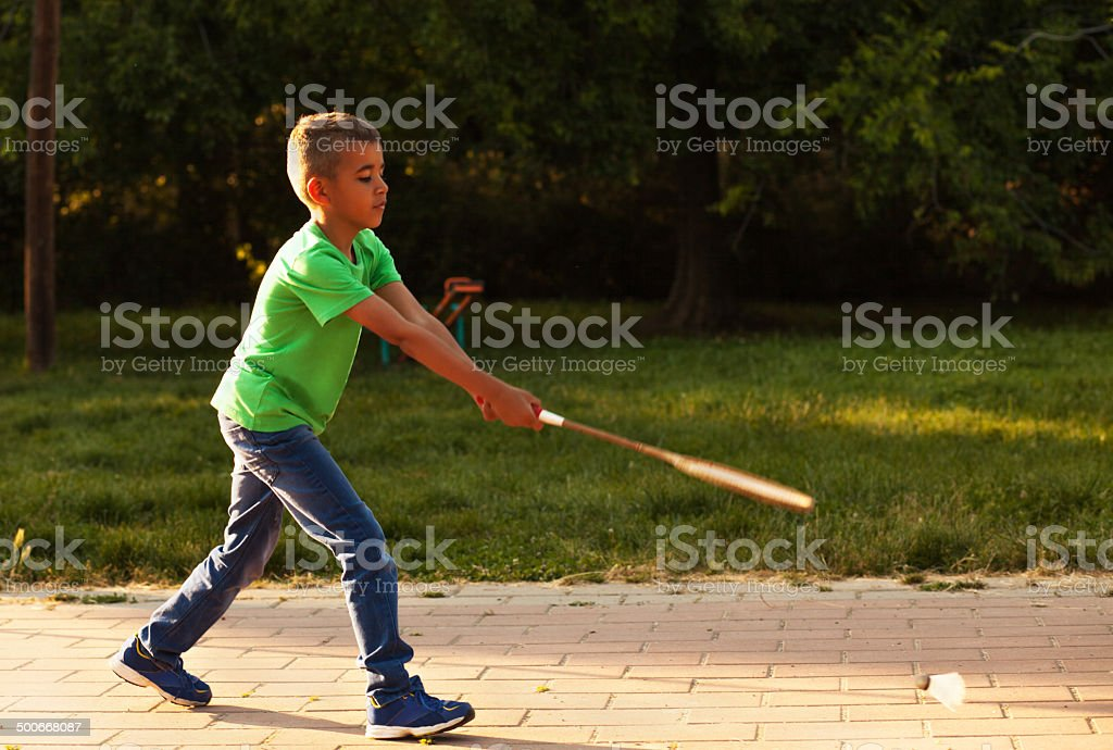 Cute mixed race teenager with a tennis racket stock photo