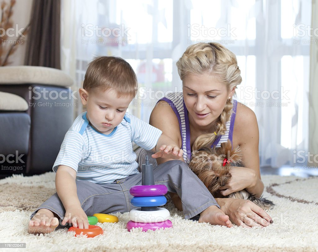 cute mother and kid boy playing together indoor royalty-free stock photo