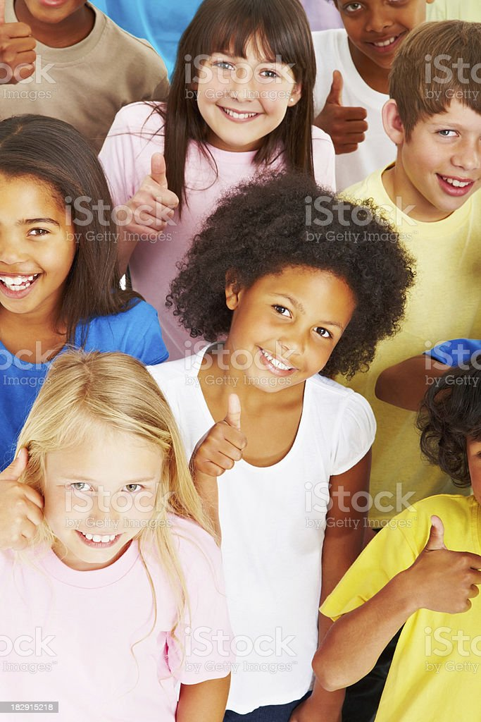 Cute multi ethnic children gesturing thumbs up royalty-free stock photo