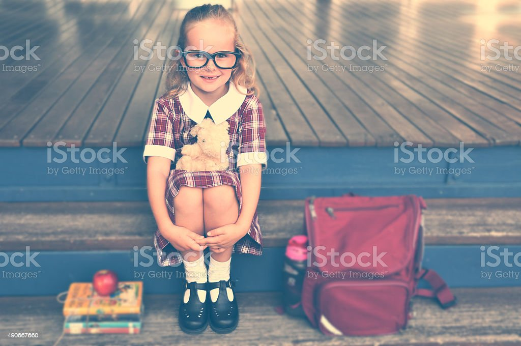 Cute Nerd sitting on steps stock photo