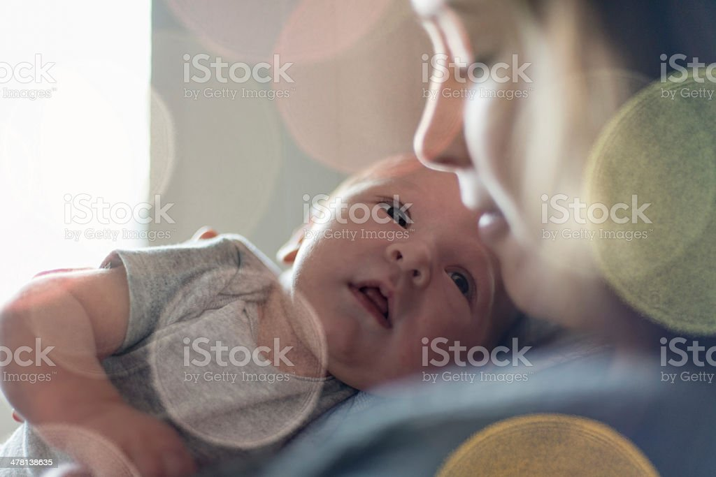 Cute newborn baby serie with pastel bokeh filter stock photo