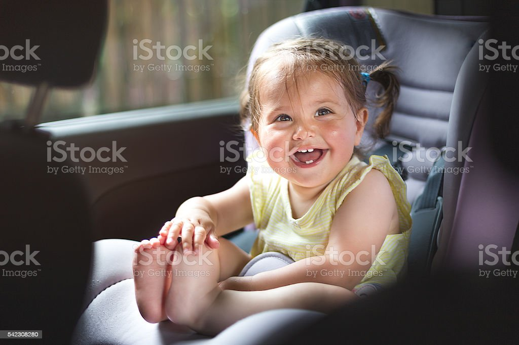 cute one year old baby is sitting in baby seat stock photo