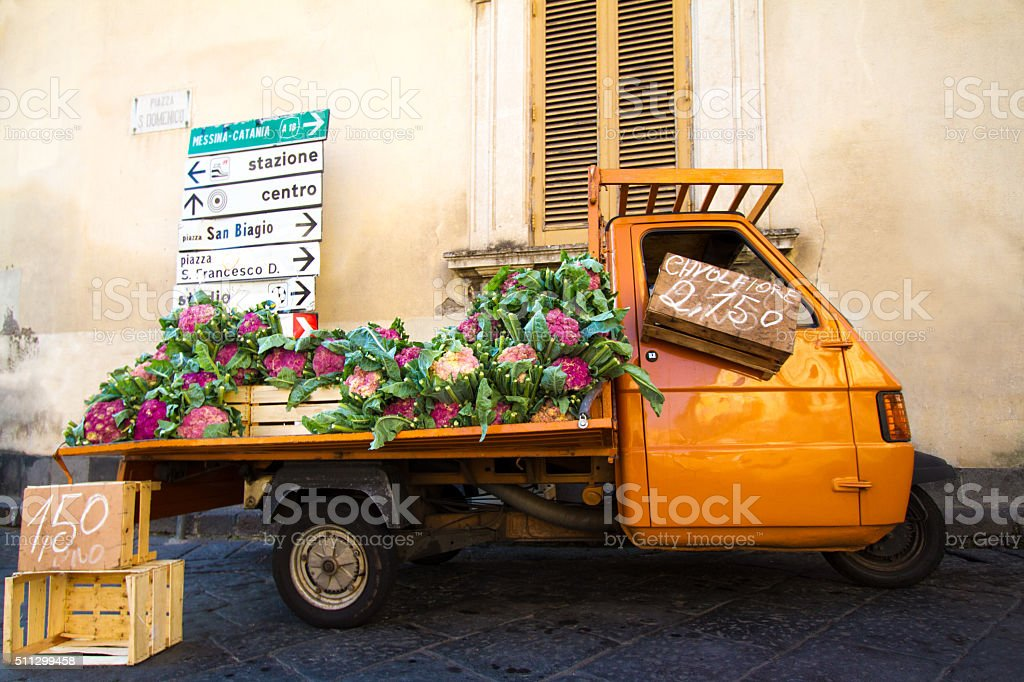 Cute Orange Truck Selling Purple Cauliflower, Sicily stock photo