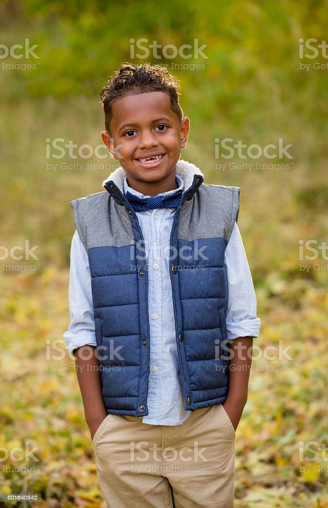 Cute outdoor portrait of a smiling African American young boy stock photo