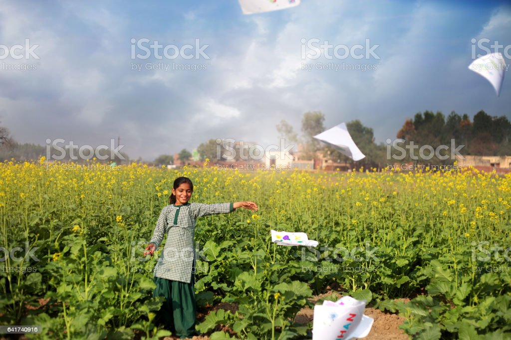 Cute playful schoolgirl in the nature stock photo
