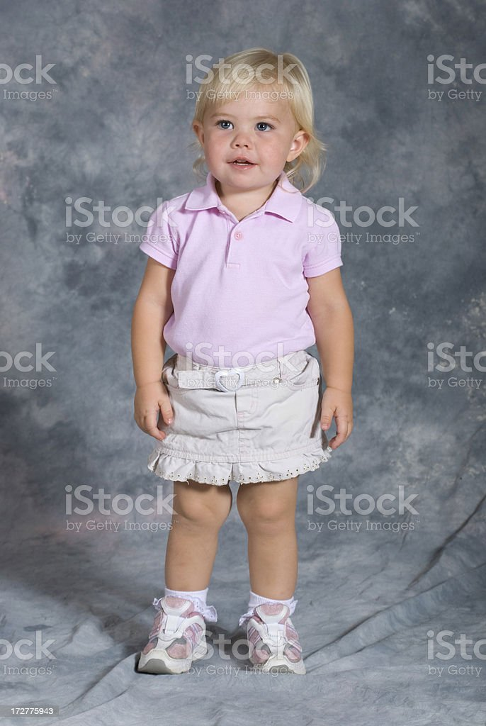 Cute portrait of girl in pink standing royalty-free stock photo