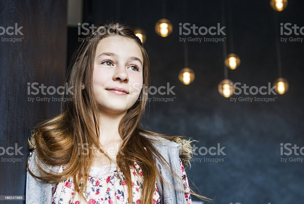 Cute Pre Teen In Front of Hanging Lights royalty-free stock photo