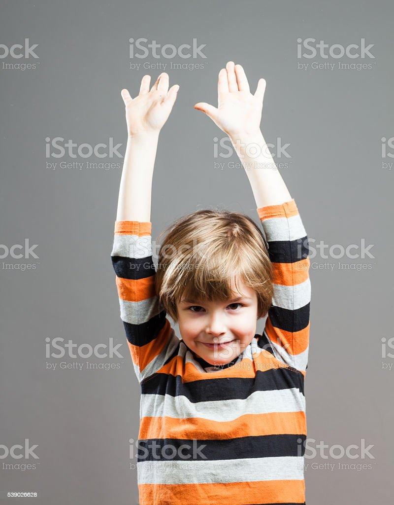 Cute Preschooler having fun, Hands up in the Air stock photo