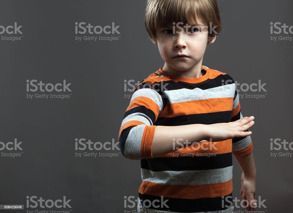 Cute Preschooler pretending to Fight stock photo