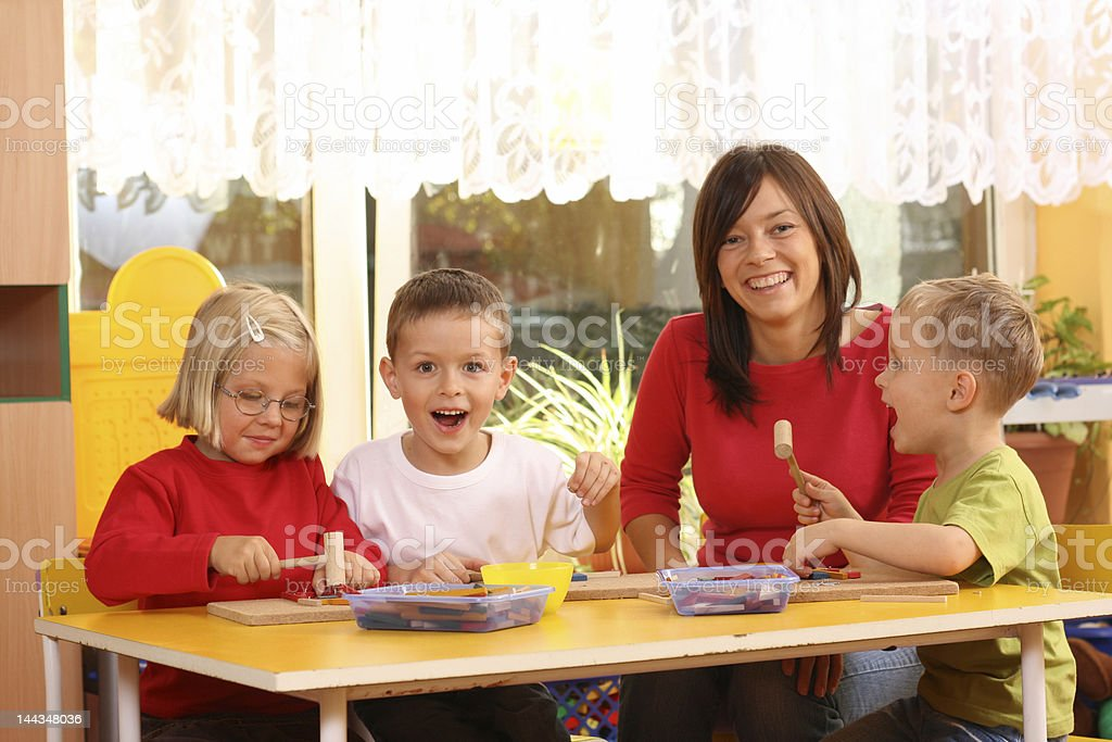 Cute preschoolers having fun class with teacher royalty-free stock photo