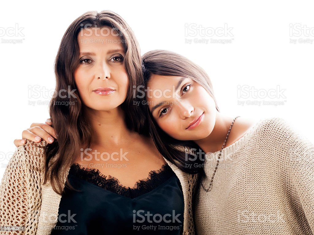 cute pretty teen daughter with mature mother hugging, fashion style stock photo