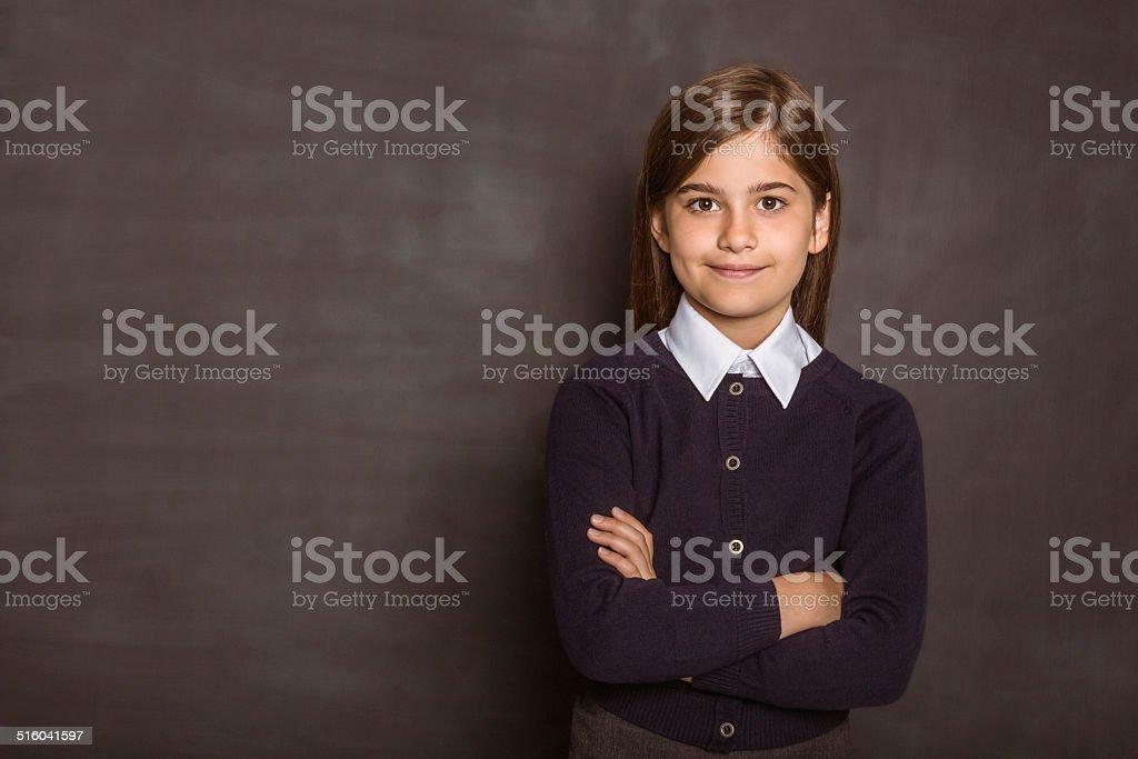 Cute pupil smiling at camera stock photo